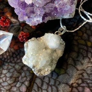 Silver foil wrapped quartz geode pendant